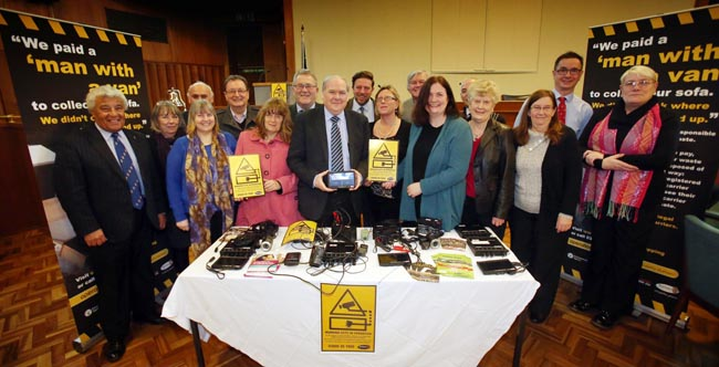 County Durham Council members showing off the fly tipping CCTV equipment